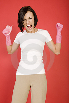 Furious cleaing woman Stock Photo