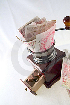 Grinding Pounds Into Pennies Stock Image - Image: 4516391