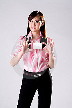 Business Woman Shows Business Card Free Stock Photography