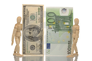 Manikins Hold Euro And Dollar Bills Royalty Free Stock Photography - Image: 4535537