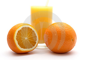 Orange and orange juice Stock Images