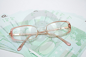 Eyeglasses And Euro Royalty Free Stock Image - Image: 4591276