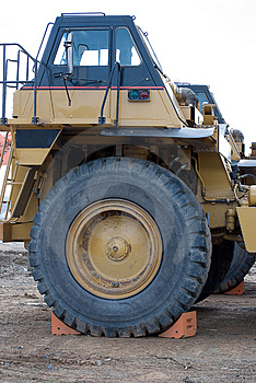 Dump Truck With Large Tire Royalty Free Stock Image - Image: 4613086