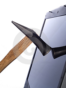 Hammer breaking laptop computer screen Stock Images