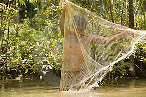 Fishing With A Throw Net Royalty Free Stock Images - Image: 4636659