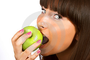 Trying To Bite Into An Apple Stock Photography - Image: 4704752