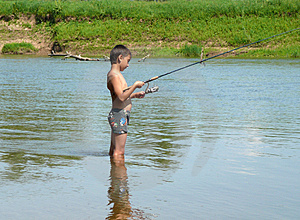 Boy Fishing With Spinning Stock Photo - Image: 4721460