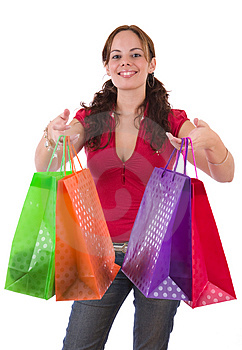 Young woman holding a few colorful shopping bags Stock Photography