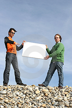 Two Young Men Holding White Card Stock Photo - Image: 4725960