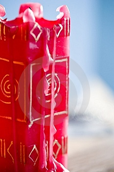 A Used Red Candle With Designs On The Side Royalty Free Stock Photos - Image: 4752208
