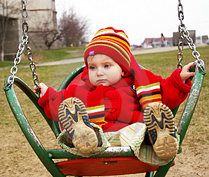 Sad Girl Drive On A Swing Royalty Free Stock Image - Image: 4769756