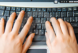 Human hands typing on the keyboard Stock Images