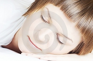 Beautiful woman in white sleeping Stock Image