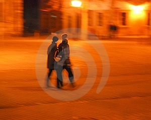 Couple Walking Over Cobblestone Pavement Stock Photo - Image: 488830