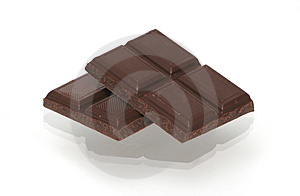 Two Segments Of Chocolate On A White Background Stock Photography - Image: 4816202