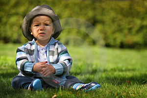Sad Boy  Sitting On The Grass Stock Photos - Image: 4857123