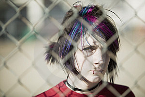 Punk Girl Behind Chain Link Royalty Free Stock Images - Image: 4863069