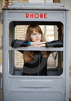 Lonely Girl In Old Phonebox Royalty Free Stock Images - Image: 4888769