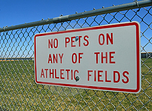 Sign On Athletic Field Fence Royalty Free Stock Photo - Image: 4892085