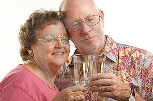 Happy Senior Couple Toasting Stock Photography