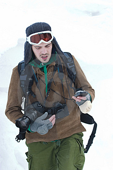 Photographer In Snow Stock Image - Image: 4901841