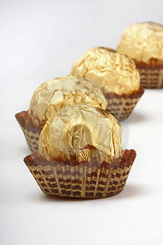Chocolate truffles in foil wrap Stock Photo