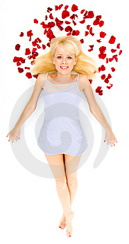 Beautiful young woman throwing rose petals Stock Image