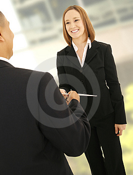 Business Man Giving Folder To Teammate Stock Photos