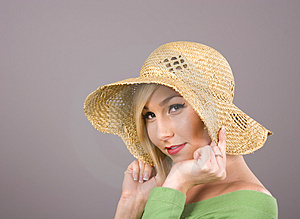 Blonde Straw Hat Over Ears Royalty Free Stock Images - Image: 4976869