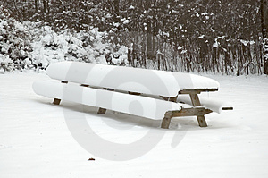 Snow Covered Picnic Table Stock Photo