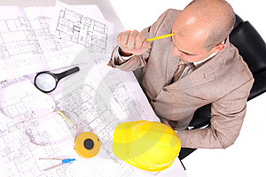 Businessman Thinking With Architectural Plans Royalty Free Stock Image - Image: 5008336