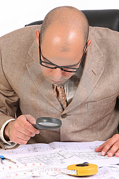 Businessman With Architectural Plans Royalty Free Stock Photography - Image: 5008407