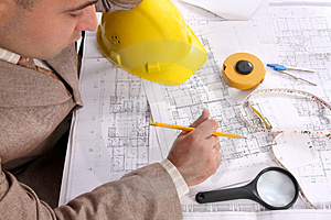 Businessman With Architectural Plans Royalty Free Stock Image - Image: 5008486