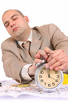 A Businessman Sleepy With Architectural Plans Royalty Free Stock Photography - Image: 5008707