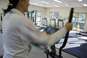 Young girl running on treadmill Stock Photos