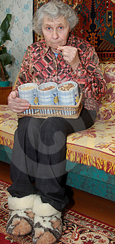 Seventy Year Old Woman Cracks Nuts Royalty Free Stock Image - Image: 5043636
