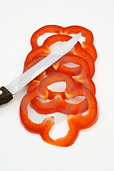Red Bell Pepper Slices With Knife Stock Photos - Image: 5047633