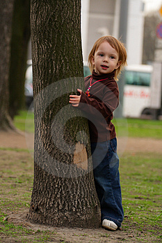 Small Girl Playing Hide-and-seek. Royalty Free Stock Images - Image: 5080839