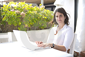 Woman With A Laptop In A Terrace Royalty Free Stock Photos - Image: 5108648