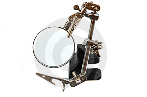 Magnifier With Clips For Soldering Royalty Free Stock Image - Image: 5131086