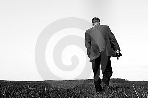 Walking gunman Stock Images