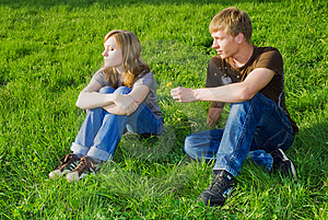 Young Couple On The Grass Stock Photo - Image: 5142820