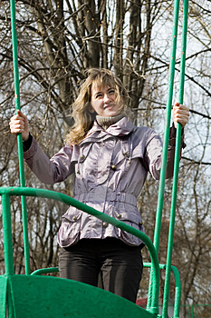 Girl In Park On Old Swing Stock Photography - Image: 5165542