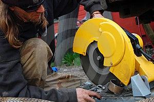 Man Operating A Cut-Off Saw Stock Photos - Image: 5174243