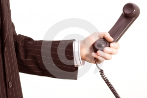 Telephone in a business hand Stock Photo
