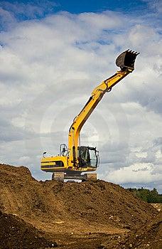 Heavy Orange Excavator Reaches The Sky Stock Images - Image: 5227454