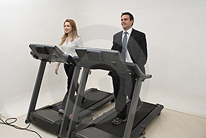 Businesspeople on Treadmill - Horizontal