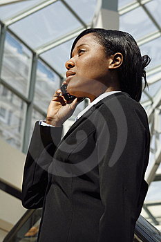 Atrium Businesswoman - Vertical Royalty Free Stock Photography