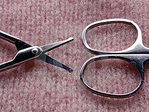 Scissors On Textured Pink Background Royalty Free Stock Photography - Image: 5286117
