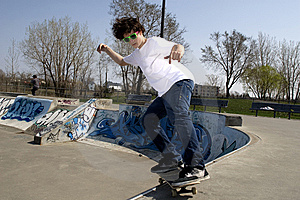 Skateboarder Doing Trick On Ramp Stock Image - Image: 5286151